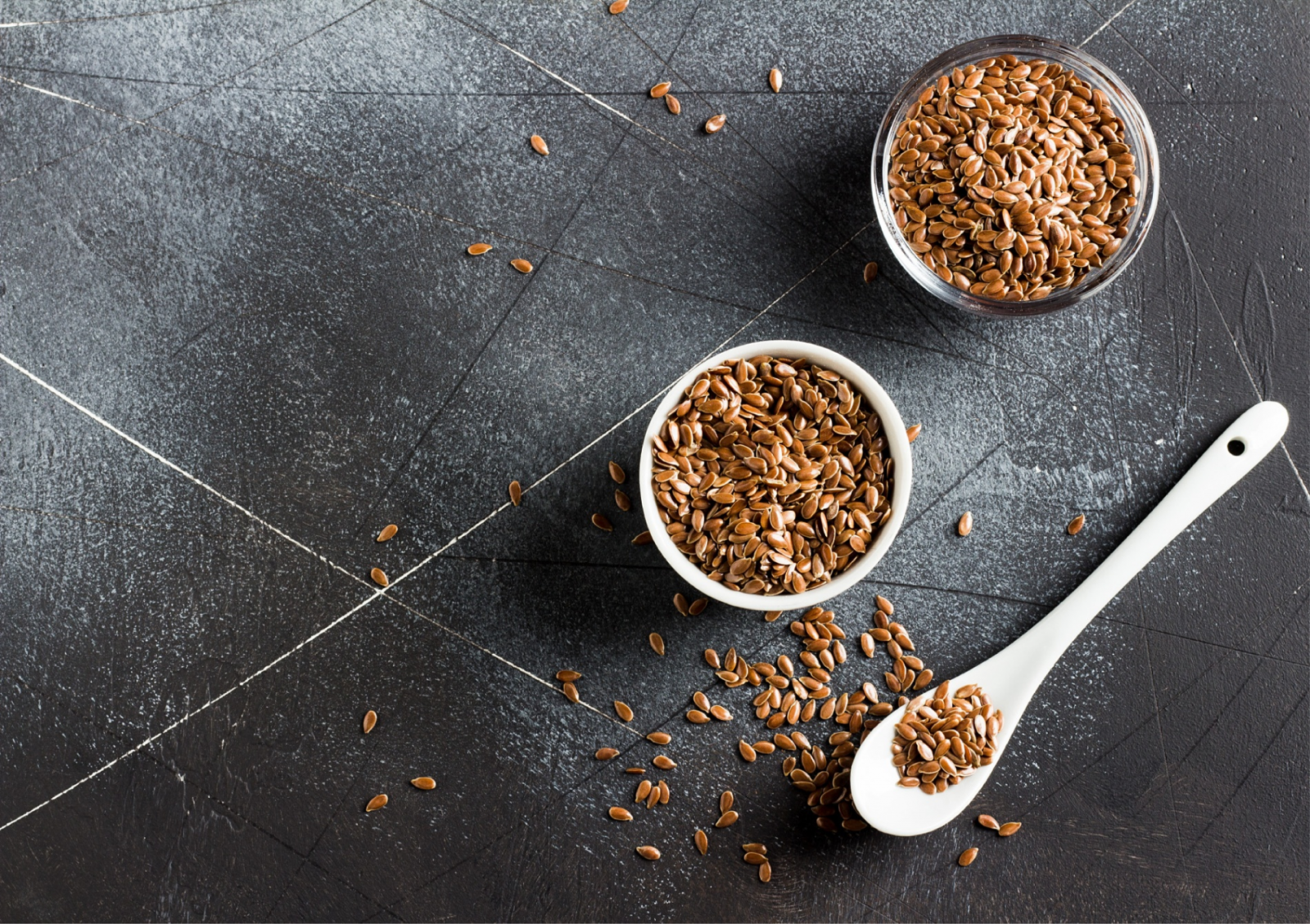 Flax seeds in bowl and spoon
